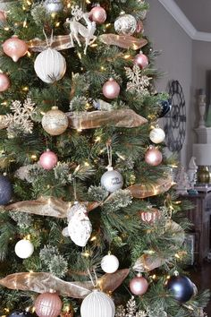A farmhouse chic inspired Christmas tree using navy and blush, with gold and silver accents. How to add farmhouse chic charm to your Christmas tree! Rose Gold Christmas Decorations, Fresh Christmas Trees, Gold Christmas Tree, Xmas Tree, Christmas Tree Decorations, Holiday Decor, Christmas Time, Traditional Christmas Tree, Christmas Tree Inspiration