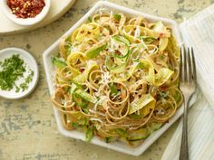 Whole-Wheat Fettuccine with Zucchini Ribbons : A combination of zucchini and yellow summer squash, cut into thin ribbons, makes this pasta as colorful as it is vegetable-packed. Whole-wheat pasta adds more fiber to the mix. The finishing touches: Parmesan and fresh herbs.