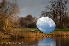 Anish Kapoor, Sky Mirror 2006, Stainless steel,1066.8 x 1066.8 cm. Installation view of Serpentine Gallery exhibition Turning the World Upside Down, Kensington Gardens. Photo: Quintin Lake