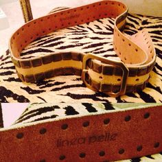 linea pelle belt, worn 2X! Subtle gold! With brushed gold grommet details. Beautiful with denim to dress up that perfect shirt or blazer! A favorite brand to many celebrities. Excellent quality. Lifetime belt. Enough holes to wear around shirts/dresses to create a different look. Great find. Looks as if it's never been worn! Linea Pelle Accessories Belts