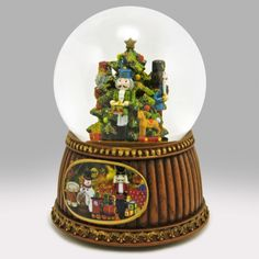 As soon as the Thanksgiving turkey is in the fridge, it's time to start decorating for Christmas. This elegant glitter globe will look great on a mantel and is sure to spread holiday cheer. Snow Globe Kit, Diy Snow Globe, Christmas Snow Globes, Nutcracker Christmas, Carousel Musical, Circus Music, Old Fashioned Toys, Glitter Globes, Musical Snow Globes