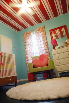 This candyland nursery is a PN favorite. Look at that striped ceiling! Striped Ceiling, Striped Walls, Ceiling Decor, Ceiling Design, Paint Stripes, Red Stripes, Teal Walls, Nursery Room, Themed Nursery