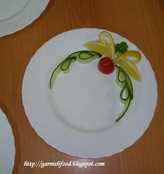 4 slices of cucumber, 2 wedge of orange, a cherry tomato and a single italian/flat leaf parsley... creative... and simple