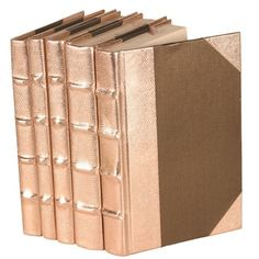 Rose Gold Metallic Bound Books (Via Joss & Main)- I could buy old books and spray paint them.
