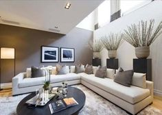contemporary neutral living room | fabulous display plinths with urns || Belgrave Mews South, Belgravia, London