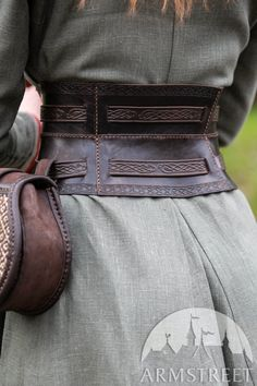"""Viking War Corset Belt with Embossing """"Gudrun the Wolfdottir"""" for sale. Available in: brown leather, black leather, milk white leather :: by medieval store ArmStreet This embossed leather belt is a more feminine rendition of Viking war belts. Vikings, Viking Clothing, Historical Clothing, Historical Photos, Corset En Cuir, Leather Corset Belt, Leather Belts, Viking Aesthetic, War Belt"""