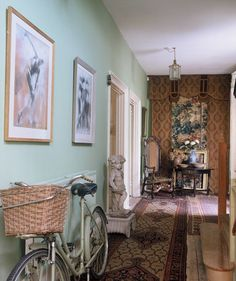 My bicycle matches the walls of the hallway and matches the sea when being ridden along the seafront.You can just see the woven antique portiere at the end. ariadnefabric.com Photo Henry Green
