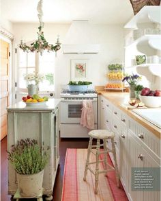 Charming kitchen! Like the narrow, tall island. Nice colours if a little brave