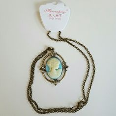 """Vintage Portrait necklace This is an adorable necklace like the old vintage portraits. This is a wonderful cameo.  Bronze color chain is 20"""" long and  and blue and white is epoxy Jewelry Necklaces"""