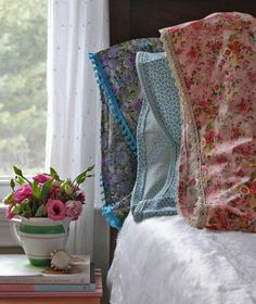 from apartmenttherapy.com I love the flowers in the pitcher idea!