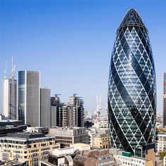 'The Gherkin' designed by Lord Foster - the building gives the illusion of using curved glass when in fact it is only used in the very top of the building, the cap.