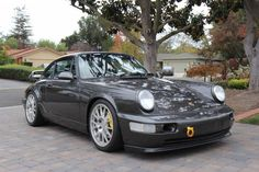 This 1990 Porsche 911 C2 (VIN WP0AB2969LS451275) runs an RSR spec 3.8 liter motor built to the tune of a documented $26k. 993 Turbo front brakes and 968 items in the rear are matched by JIC coilovers, and the engine is said to have just under 15k miles from new. We like the factory Slate Grey Metall