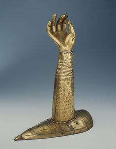 Arm Reliquary Date: 1130–40 Culture: German (Hildesheim) Medium: Gilded copper Dimensions: H. Arm: 18 7/8 in. (48 cm); Base: 14 91/6 x 7 7/8 in. (37 x 20 cm) Classification: Metalwork-Copper alloy Credit Line: Dom-Museum Hildesheim, on loan from the church of St. Maurice, Hildesheim (L 1994-2)  http://www.metmuseum.org/exhibitions/view?exhibitionId=%7B0CEDC8EE-3623-4075-AABF-7518259E37E2%7D&oid=478633&pg=1&rpp=20&pos=14&ft=*