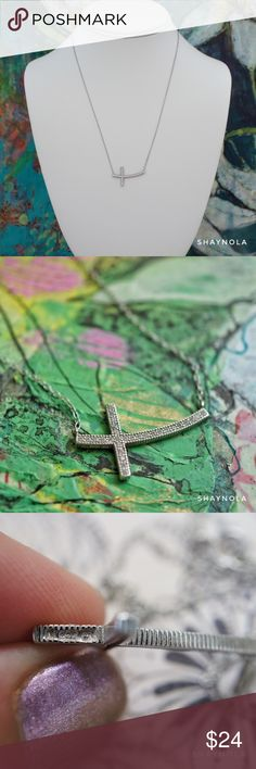 """Sterling Silver Sideways Cross w Crystal Accents A beautiful sterling sideways cross with crystal accents. Excellent condition. No stones missing. Stamped 925 on side of cross and clasp. Adjustable 16-18"""". Sterling Silver Jewelry Necklaces"""
