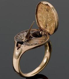 tawnyscostumesandcuriosities: 1570: A rare 16th century gold sundial and compass ring, possibly German, The hinged oval bezel designed as a seal and engraved with a coat of arms, opening to reveal a sundial and compass, on a plain gold hoop, dimensions of bezel 1.8x2.0cm - Gift for women and girls, wedding & bridal. In our collection you'll find gold & 925 sterling silver products, ring, necklaces, earrings, bracelets, brooches, cuff links with Swarovski crystals. Sale 50% off!