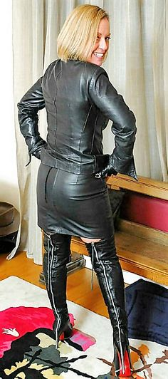 Blonde amateur posing in black leather jacket miniskirt thigh boots