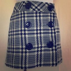 Express plaid mini skirt Super cute black and white wool blend skirt with bottoms up the front.  Fully lined. Like new. Express Skirts Mini