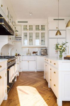 white kitchen with chevron floors