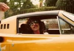 George Harrison (in one of his cars driving into the gates of Friar Park in 1978. He stopped for a few minutes and talked to a couple fans Sue Link & Denny Suba. Photo by Denny Suba) (source: meet the beatles for real blog)