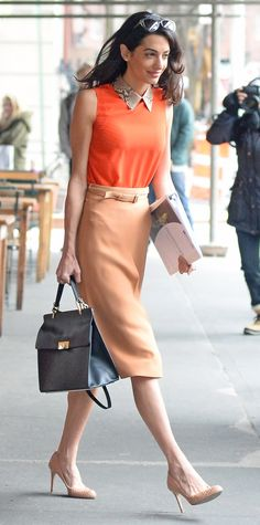 Put together your ensemble around one statement piece. In Clooney's case, it's her persimmon orange top. Soften the bold shade with colors from the same family, like peach and nude.