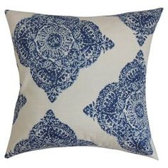 """Cotton throw pillow in indigo with an ikat medallion motif and feather-down fill. Made in the USA.  Product: PillowConstruction Material: Cotton and polyester cover and down fillColor: IndigoFeatures:  ReversibleInsert includedClean knife-edge finishMade in the USA Dimensions: 18"""" x 18""""Note: Dry cleaning recommended"""