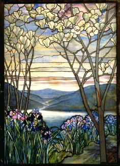 """1908 Louis Comfort Tiffany """"Magnolias and Irises"""" Window.  Medium: Leaded Favrile glass  This Tiffany Studios window was designed as a memorial to the Frank family of New York and was originally installed in a mausoleum of a Brooklyn cemetery. The River of Life theme is prevalent in Tiffany landscapes created for memorials."""