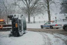 An SUV overturned on New York Avenue in Huntington as a storm drops snow across Long Island on Thursday, Feb. 13, 2014. (Credit: Steve Pfost)