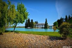 House surrounded by a private 10 acre lake? Stunning! And its down the street...