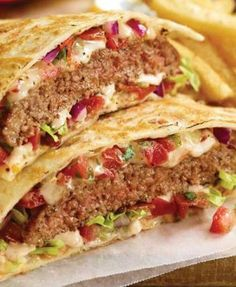 (Applebee's new Quesadilla Burger) Take your taste buds for a Southwest joyride. A juicy burger with our signature Mexi-ranch sauce with pico de gallo and shredded lettuce. Served in a mouthwatering Jack and cheddar quesadilla (contains bacon). Easy Dinner Recipes, Great Recipes, Favorite Recipes, Fast Recipes, Lunch Recipes, Dinner Ideas, Hamburger Recipes, Ground Beef Recipes, Leftover Hamburger Patties Recipe