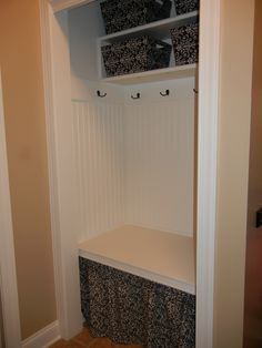 Mini Mudroom!  Formerly a small closet with sliding doors that held my cat litter box and not much else.  The litterbox is now behind the curtain and the rest of the space much more useful!!!  Thanks to my husband for building it!