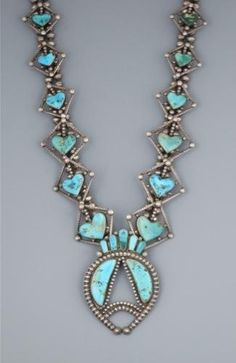light blue turquoise heart necklace.