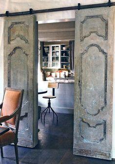 Entrance -- sliding door into office, antique french door, black top railing