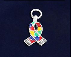 Small Autism Ribbon Charms. These 2 sided autism ribbon charms are approximately 1.8 cm x 1.1 cm. Packaged 25 charms per pack. Product Code: CHARM-06-2