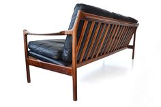 Three seater sofa by Gunnar Myrstrand, Denmark, 1960′s. Beautiful organic shaped frame made of solid rosewood with authentic finger joints. Black leather upholstery: six loose cushions finished with a piping and an upholstered bottom.