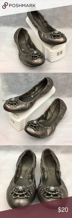 Gagarin silver flats Pre owned Tahari silver ballet shoes in great shape!  These do have a few small scuff marks as seen in the pictures.  Please zoom in to check these out. Smoke and pet free house Tahari Shoes Flats & Loafers