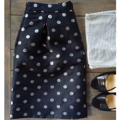 """J. Crew Silver Dot Jacquard Skirt Like new, worn maybe once. Current style - holiday '15. Fully lined skirt with pleats in front and back. Pockets! Metallic silver dots on black fabric. 15"""" across waist and 18.5"""" long. Zipper in back with hook closure. J. Crew Skirts"""