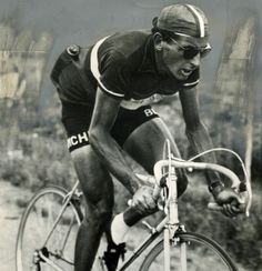 COPPI, THE DESTROYER, IN SUNGLASSES, WITH WRISTWATCH, CAP BACKWARDS, AND WHITE SOCKS, OF COURSE.