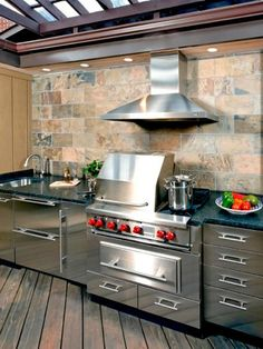 Consider a ventilation hood for your outdoor kitchen if your setup is close to the house. It will save you from smoke and cooking odors that creep up during grilling and find a way into your home. Photo courtesy of Danver Stainless Steel