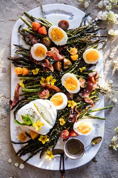 Sesame Roasted Asparagus, Egg and Bacon Salad - The trick, lay the bacon over the asparagus. The fat drips down adding amazing flavor! @halfbakedharvest.com