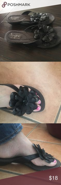Born size 9 black flip flops Adorable black flip flips with large leather flower.  Great condition. Just too big for me. I usually wear an 8.5 Born Shoes Sandals