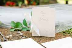 Wedding details. Spring wedding. Spring colors. Blush, ivory, sage green color palette. Wedding program book. Wedding Photography. Wedding day details. Wedding Stationary from By Invitation Only in Little Rock, Arkansas.