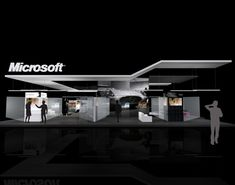 Microsoft  Designed for Pinnacle Exhibits.  A 12m x 15m exhibit for Photokina in Germany. Showcasing the latest photo software technology with an employee photo gallery. Canopies define the space and contain the experience. Depth springs from glass and reflective materials. A theater greets attendees at the front, while product categories live around the perimeter. The central core is tech and conference.