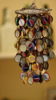 bottle-cap wind-chime: easy craft project for boys old enough to use a hand drill.    J is going to LOVE this.