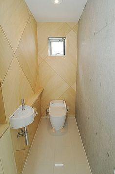 打放しコンクリート+シナ合板目透し貼トイレ