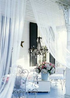 Drapes and a chandelier add that special something to this verandah.