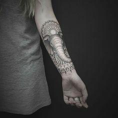 arm geometric elephant tattoo