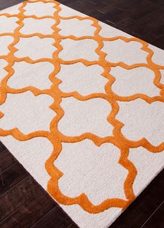 This orange and white rug is a great pop of color for the #nursery