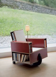 Armchair, Bookinist, a chair-cum-bookshelf on wheels, with a reading light, cup holder, secret compartment, by Nils Holger Moormann