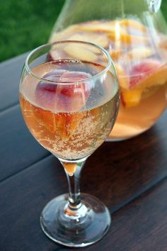 Sparkling White Peach Sangria: 1 ml) bottle Riesling, or other white wine of your choice 4 peaches, cut into wedges (about 2 cups) 2 tablespoons sugar (optional) cup peach vodka 1 ml) bottle chilled peach flavored sparkling wine White Peach Sangria, Peach Vodka, Peach Schnapps, Peach Wine, Sangria Recipes, Wine Recipes, Cocktail Recipes, Sangria Ingredients, Fun Drinks