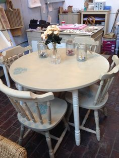 I've painted this table and Four chairs in Country Grey & Old White a Chalk Paint™ by Annie Sloan.